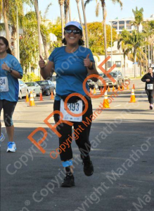 Somewhere after Mile 11 when I realized I was going to meet/beat my goal time! This may be one of my favorite race photos to date!